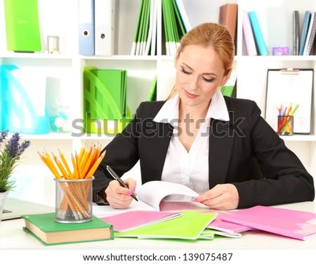 Portrait of teacher woman working in classroom - stock photo