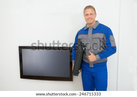 Portrait Of Technician Holding Amplifier Showing Thumb Up - stock photo
