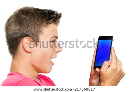 Portrait of Teen boy holding smart phone with surprised face expression.Isolated on white background. - stock photo
