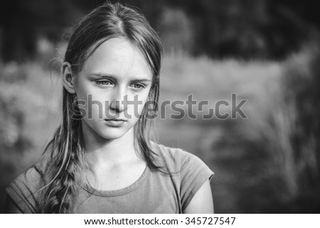 Portrait of teen girl standing on the nature - stock photo