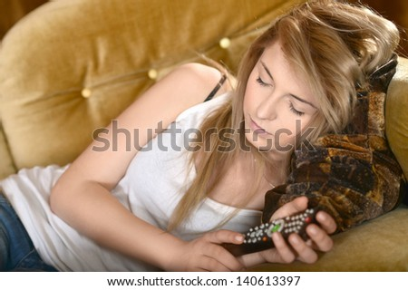 portrait of teen girls resting on sofa at home - stock photo