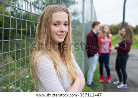 Portrait Of Teenage Girl Hanging Out With Friends In Playground - stock photo