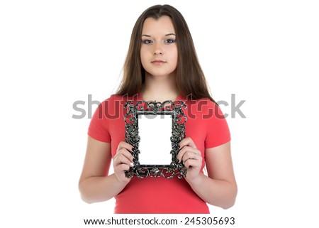 Portrait of teenage girl holding photo frame on white background - stock photo