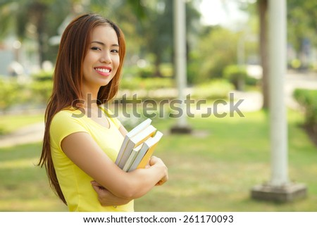 Portrait of teenage girl with textbooks - stock photo