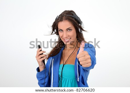 Portrait of teenager listening to music with headphones - stock photo