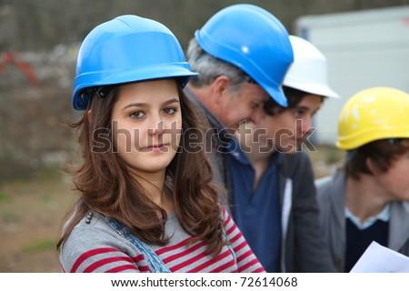 Portrait of teenager with security helmet - stock photo