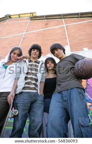 Portrait of teenagers with skateboards - stock photo