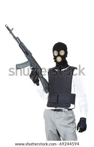 Portrait of terrorist in balaclava holding rifle on white background - stock photo