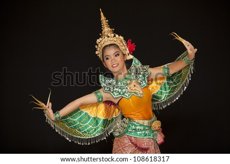 Portrait of Thai young lady in an ancient Thailand dance wea with isolated  background. - stock photo