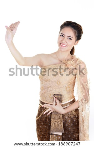 Portrait of Thai young lady in an ancient Thailand dance  with isolated background. - stock photo