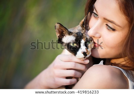Portrait of the attractive girl with sphynx - stock photo