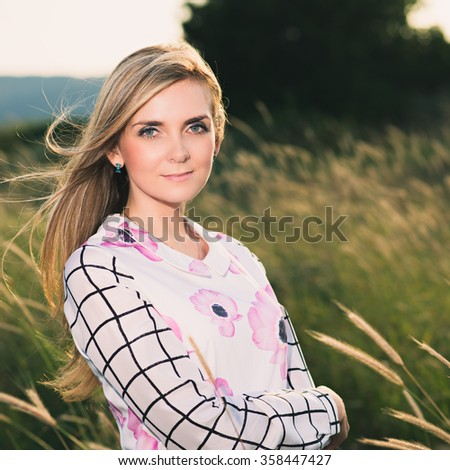 portrait of the attractive, slender, beautiful young Caucasian  blonde girl outdoor. Photo with instagram style filters - stock photo