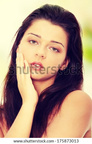Portrait of the attractive topless girl without a make-up - stock photo