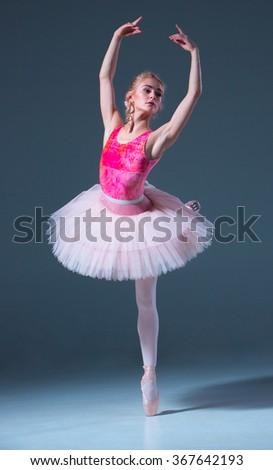 Portrait of the ballerina in ballet pose - stock photo