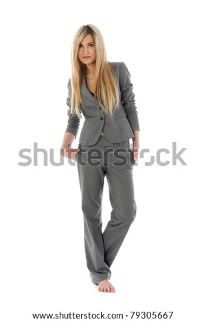 Portrait of the beautiful blonde in a grey costume. Isolated image - stock photo