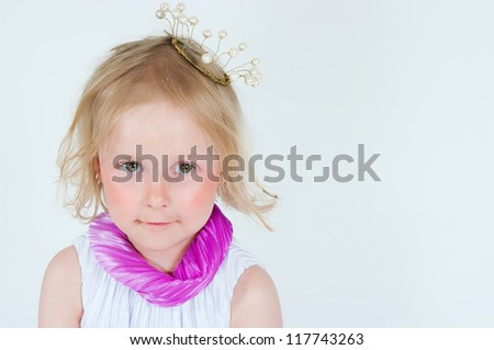 Portrait of the beautiful girl in a crown - stock photo