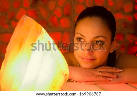 Portrait of the beautiful girl in salt room. - stock photo