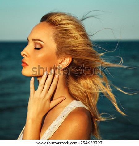Portrait of the beautiful girl, the wind fluttering hair. - stock photo