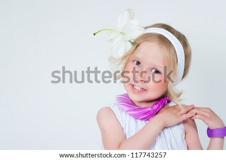 Portrait of the beautiful girl with a lily flower - stock photo