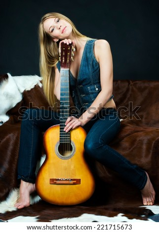 Portrait of the beautiful musician with guitar - stock photo