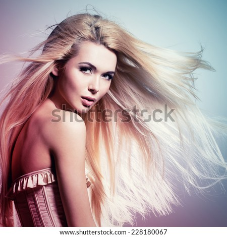 Portrait of the beautiful sexy woman with long blonde hair. Concept image is in tinting colorize style - stock photo