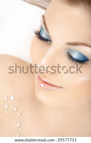 Portrait of the beautiful woman blindly and a blue make-up - stock photo