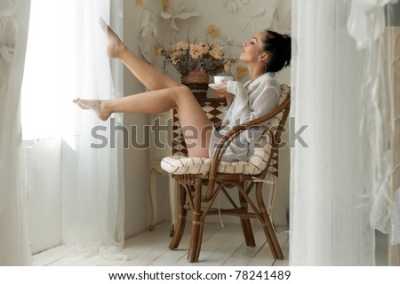 Portrait of the beautiful woman drinking tea in the morning - stock photo