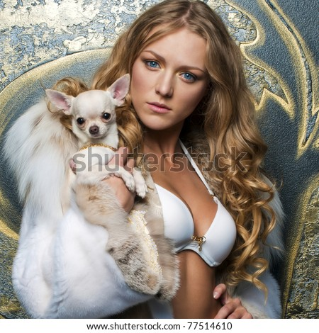 Portrait of the beautiful woman in fur coat with chihuahua - stock photo