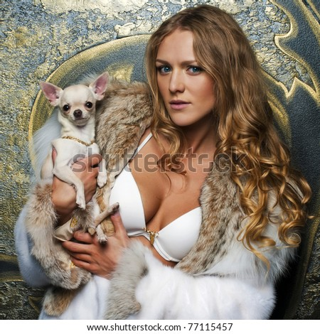 Portrait of the beautiful woman in furcoat with chihuahua - stock photo