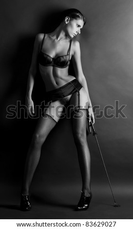 Portrait of the beautiful woman in underwear with switch - stock photo
