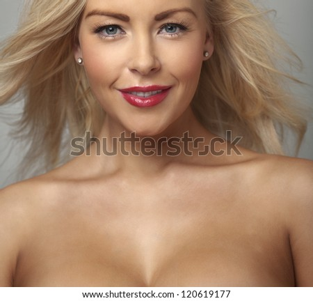 Portrait of the beautiful woman with flying hair - stock photo