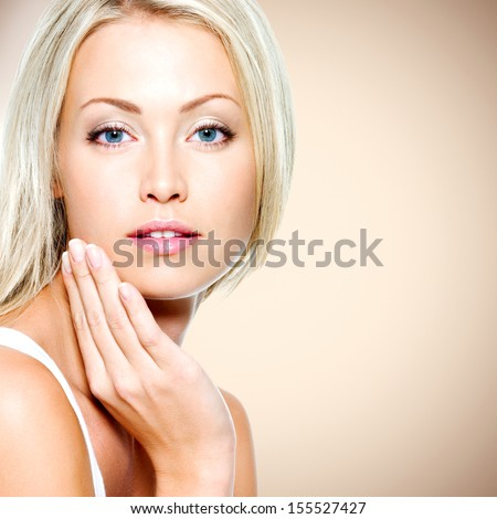 Portrait of the beautiful woman with health clean skin - stock photo