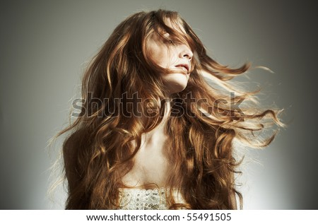 Portrait of the beautiful woman with red curly hair - stock photo