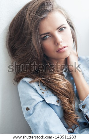 portrait of the beautiful young girl with long brown hair in studio - stock photo