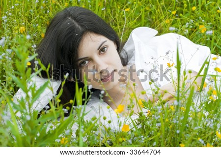 Portrait of the beautiful young woman on the meadow - stock photo