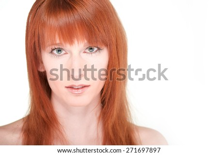Portrait of the beautiful young woman with red long hair on white background - stock photo