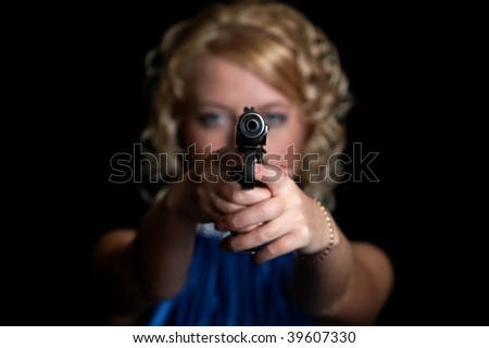 portrait of the blonde with gun isolated on black background - stock photo