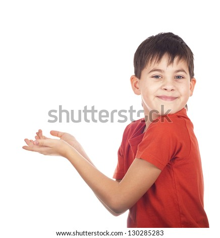 portrait of the boy in a red undershirt which holds an imagined subject on a white background - stock photo