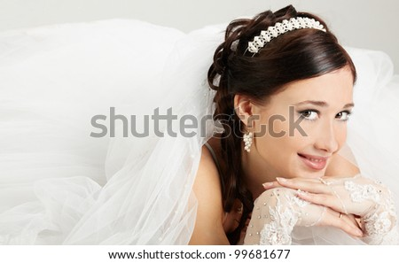 Portrait of the bride in a wedding dress - stock photo