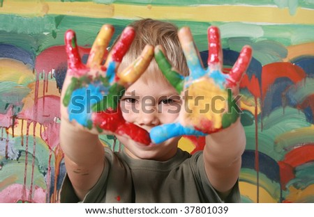 Portrait of the cheerful boy the ornamented palms. - stock photo