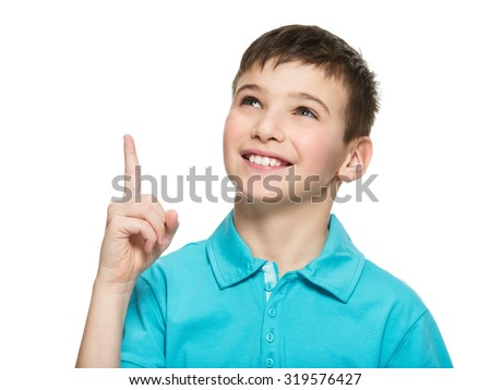 Portrait of the cheerful teen boy pointing finger up -  isolated over white background - stock photo