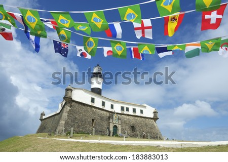 Portrait of the Farol da Barra Salvador Brazil lighthouse with celebratory international flag bunting - stock photo