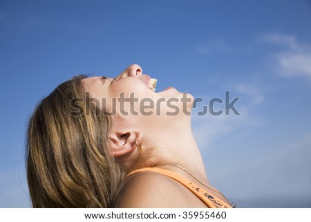 Portrait of the girl in a profile with the opened mouth - stock photo