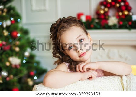 Portrait of the girl near christmas tree - stock photo