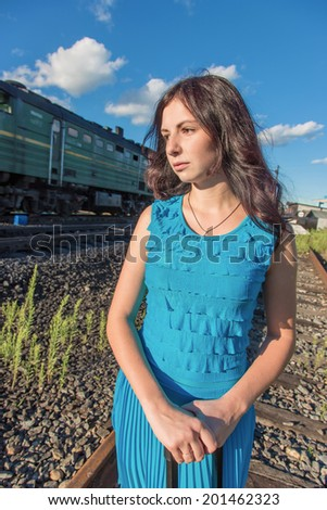 Portrait of the girl on a background of a passing train - stock photo