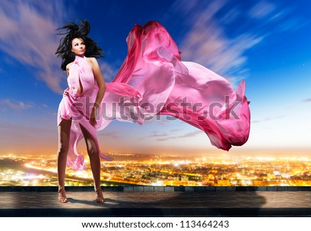 Portrait of the girl with  flyaway hair in the background of city - stock photo