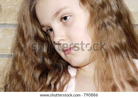 Portrait of the girl with the dismissed hair. - stock photo