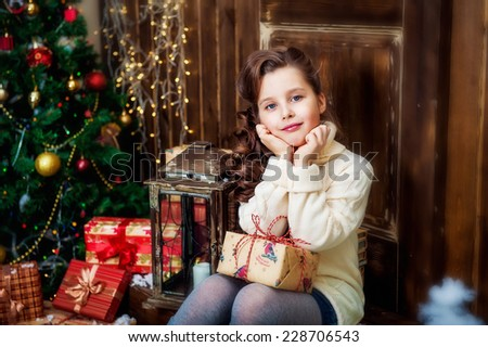 Portrait of the girl with the packaged gift - stock photo