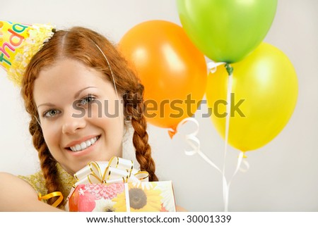 Portrait of the happy birthday woman with gifts - stock photo