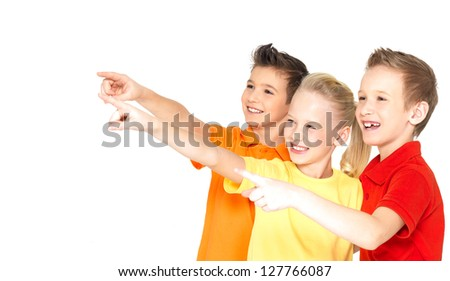Portrait of the happy children point by finger on something away -  isolated on white - stock photo